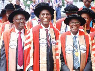 Emeritus Prof. Ayo Bangbose; new Honorary Fellow of Nigerian Academy of Letters (NAL), Mr. Sam Omatseye and President of NAL, Prof. B. Olatunji Oloruntimehin shortly after the investiture at University of Lagos Main Auditorium… in Lagos                                                                            PHOTO: SUNDAY AKIOLU