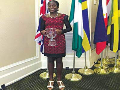 Georgia Oboh displaying her trophy at the end of the US Kids Golf Teen World Championship in North