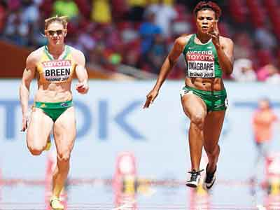 False dawn... Blessing Okagbare-Ighoteguonor (right) beat Australia's Melissa Breen and other challengers in the heat of the 100m women race before yesterday's final in which she placed last. PHOTO: AFP.