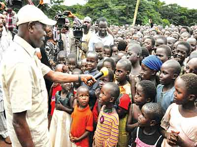 Governor Adams Oshiomhole when he visited the camp with some of the displaced children...recently