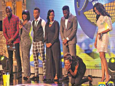 Project Fame hosts with the contestants on stage.