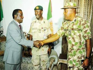 Plateau State Governor Simon Lalong (left), outgoing commander of the Special Task Force (STF), Major-General David Enetie and new STF Commander, Major-General Tagbo Ude during a courtesy visit on the governor in Jos on Wednesday