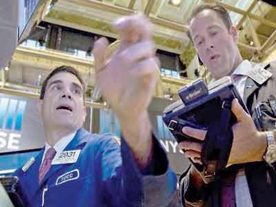 Stockbrokers on the floor of New York Exchange
