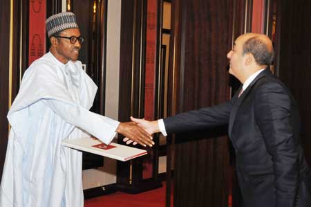 President Buhari recieivng the letter of credence from the new Turkish ambassador to Nigeria, Hakan Cakil at the State House, Abuja, today.