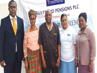 Abuja Regional Manager of Trustfund Pensions Plc., Peter Okonjo(Left); Obasi Ngozi (participant); Akpom Gilbert (participant); Trustfund Customers' Relationship Management Officer, Maha Longe; and Gbadebo Sekinat (participant); at the Trustfund Pensions Customers' Forum in Abuja.
