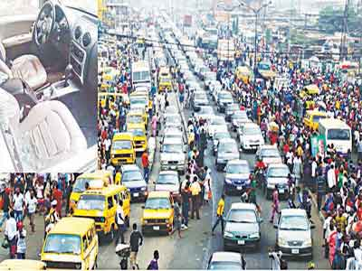 A typical traffic in Lagos. Inset is a car attacked by robbers