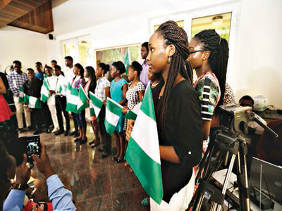 The scholars holding Nigerian flag aloft, as ambassadors to UWC campuses around the world