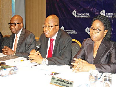 Managing Director, Continental Reinsurance Plc,  Olufemi Oyetunji (left); Executive Director,  David Sobanjo; and Company Secretary, Mrs. Abimbola Falana,. at the company's yearly  general meeting in Lagos