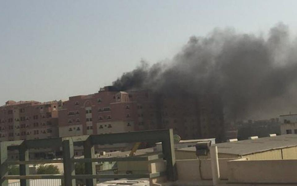 Thick black smoke billows from a fire at a multistory residential compound known as Radium that accommodates workers for state oil giant Saudi Aramco, in the eastern city of Khobar, Saudi Arabia, Sunday, Aug. 30, 2015. The fire broke out Sunday in the basement of the sprawling residential complex in Saudi Arabia's oil-rich east, killing at least 10 people and injuring more than 200, with some of the injured in critical condition, officials in the kingdom said. (AP Photo)