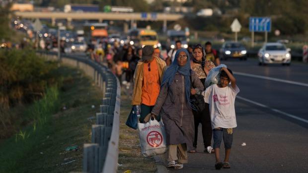 Migrants begin walking towards the Austrian border in Bicske, near Budapest, Hungary, on.  PHOTO: stuff