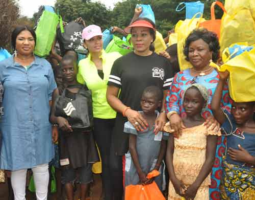Mrs Iara Oshiomhole, wife of the Governor of Edo State (2nd left) flanked by Mrs Endurance Odubu, wife of the Deputy Governor (2nd right); Mrs Marian Edoror, wife of the Speaker, Edo State House of Assembly (left); and Mrs Lucy Omagbon, Chairman, Ovia North East Local Gobvernment Area (right) at the Internally Displaced Persons Camp in Uhogua, Benin City Edo State, during the Governor's wife's visit to the camp to present some items to the IDPs, on Friday.