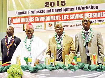Chairman, Lagos State Branch, Association of Private Practising Surveyors of Nigeria, Mr. Olufemi Odetunmibi (left), Chairman of the Occasion Mr. Michael Adio (2nd Left), Special Guest of Honour, Prof. Francis  Fajemirokun (1st Right) and Acting Chairman, Nigerian Institution of Surveyors (NIS), Surv. Gbenga Alara (Right) during 2015 Annual Professional Development Workshop at Alausa, Ikeja, Lagos.