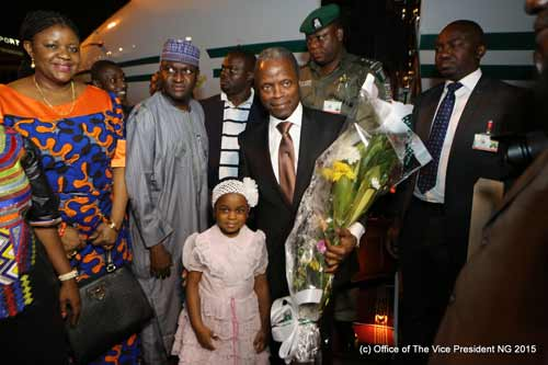 Vice President, Prof. Yemi Osinbajo (SAN) receives flowers from Princess while Her Excellency Ambassador  Ifeoma Jacinte  AKABOGU- CHINWUBA, mni, Head of Mission of the Embassy of Nigeria in Côte d'Ivoire looks on.