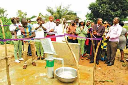 IDP Chairman pumping the borehole.