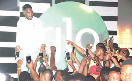 Burna Boy performing at the Glo Laffta Fest in Lagos.