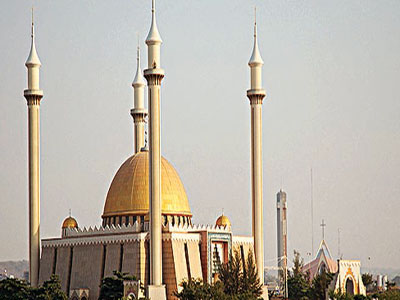Muslims walk into Abuja National Mosque for their juma't prayers