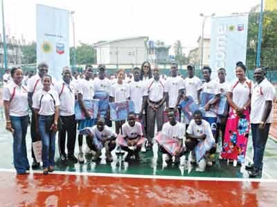 Angel MCleod (seventh left) and other participants at the closing ceremony of the 2015 Chevron Tennis Clinic held at the Lagos Lawn Tennis Club, Onikan.