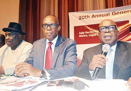 Vice-Chairman, Consolidated Hallmark Insurance Plc, Tony Aletor (left); Managing Director, Eddie Efekoha; and Chairman, Ugo Obi Ralph Ekezie, at the 20th yearly general meeting of the company, in Lagos.