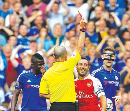 Referee Mike Dean (second left) sends off Arsenal's Santi Cazorla (second right) during Saturday's English Premier League game in London. PHOTO: AFP