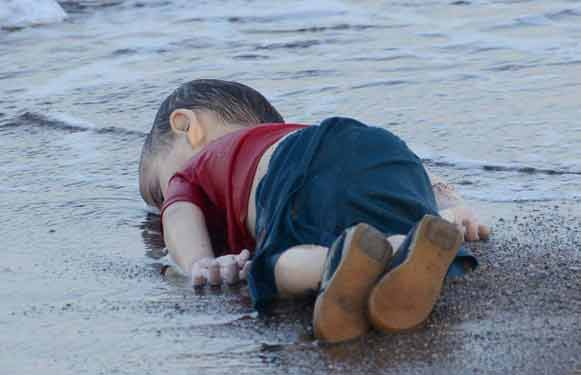 Aylan lies wasted as the world watches in horror
