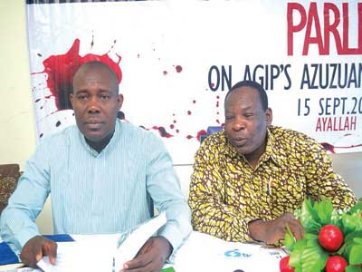 """Bayelsa State Commissioner for Environment, Mr. Inuro Wills (left) and Executive Director of ERA/FoEN, Godwin Uyi Ojo during  a formal presentation of the group's official report on the incident titled """"Agip's Azuzuama Tragedy"""" to newsmen in Yenagoa, Bayelsa State, recently"""