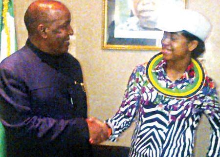 Tanzanian Ambassador to Nigeria, Daniel Ole Njoolay in a handshake with Zuriel during the visit.