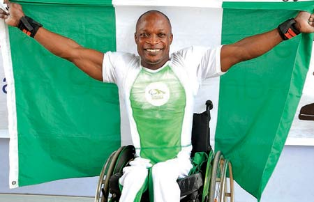 Yakubu Adesokan celebrates after setting a new world record in the Men's 49kg powerlifting event at the on-going Congo 2015 African Games. He lifted 182.5kg to give Nigeria yet another gold medal at the games.