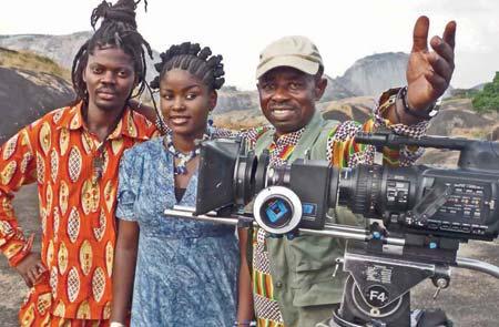 Segun Adefila; an actress and filmmaker Tunde Kelani on film set