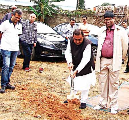 Patel with shovel laying the foundation of the hospital while on his right is the immediate past president, Rotary Club of Lagos Palmgrove Estate, Ramesh Biswal and on his left is the current President of the club, Pradeep Pahalwani                            PHOTO:  ISAAC TAIWO