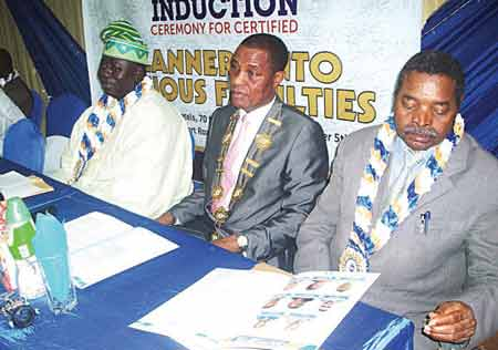 President of Institute of Planning, Nigeria Dr McCarthy Ijiebor (middle); a director, National Planning Commission, Dr. Tunde Lawal (left) and a member of the board of trustees,Prof. Ebhomielen Pius during the induction ceremony in Lagos, recently