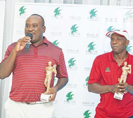 Michael Ikpoki (left) and Olateju Ogunwomoju with their trophies at the end of the just concluded International Pairs in Lagos.