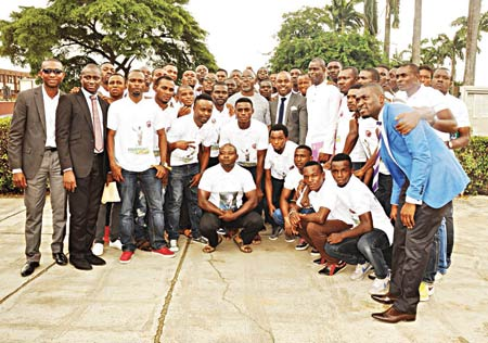 NFF President, Amaju Pinnick (centre), with players and officials of MFM FC after the club's thanksgiving service in Lagos…at the weekend.