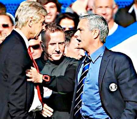 No fighting.... This official seems to tell Wenger and Mourinho during their last meeing at the Emirates Stadium PHOTO: AFP