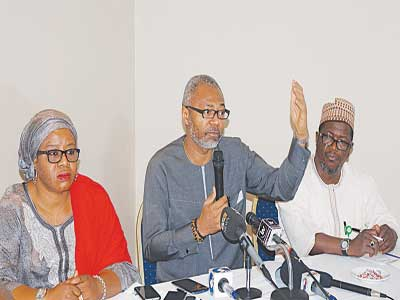 Deputy Director, Public Affairs, National Broadcasting Commission(NBC), Maimuna Jimada (left); Director General, NBC, Emeka Mba; and Director, Public Affairs, Mallam Awwalu Salihu at a press conference on digital switch over in Nigeria by NBC, in Lagos …yesterday PHOTO: SUNDAY AKINLOLA