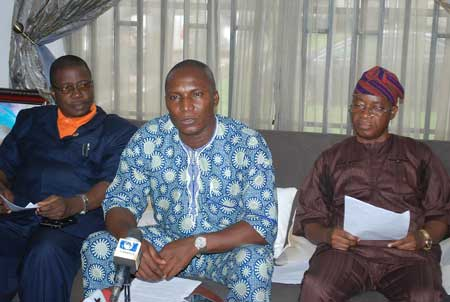 Chairman Nigeria Labour Congress Osun (NLC), Comrade Jacob Adekomi (middle), Chief of Staff to the Governor, Alhaji Gboyega Oyetola (right), and  Head of Service Mr Sunday Owoeye,  during the signing of memorandum of understanding between the labour and Government State of Osun on payment of workers salary at Government House on 16-09-2015.