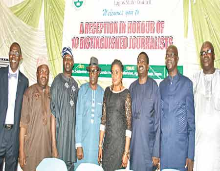 Some of the honourees: General Manager, Lagos Television, Deji Balogun (left); General Manager, Lagos Traffic Radio, Yinka Adagun; Chief Press Secretary to Lagos State Governor, Habib Haruna; Permanent Secretary, Lagos State  Ministry of Information, Fola Adeyemi; General Manager, Radio Lagos/Eko FM, Funke Moore; Special Adviser on Media to the President, Femi Adesina; NUJ President, Waheed Odusile and NUJ, Lagos Council Chairman, Deji Elumoye at the event.   PHOTO: OSENI YUSUF