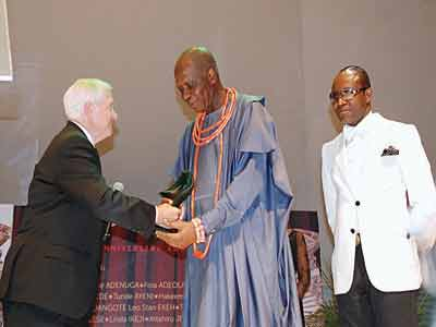 Former United States Secretary of Defence and ex-Director, Central Intelligence, Robert M. Gates (left); erstwhile Group Managing Director, (GMD), Nigerian National Petroleum Corporation (NNPC) Jackson Gaius-Obaseki and the incumbent GMD, Emmanuel Kachikwu at Thisday newspaper's 20th anniversary awards in Lagos.