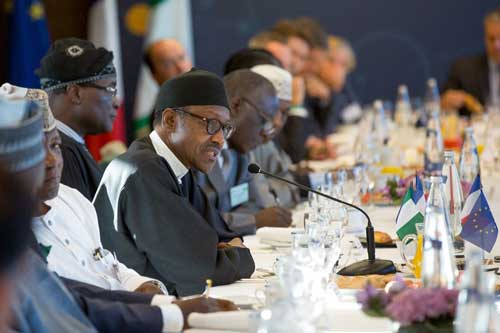 President Muhammadu Buhari, flanked by Nigerian officials during the High Level Business Breakfast Session with French and Nigerian CEOs at MEDEF Headquarters in Paris on 15th Sept 2015