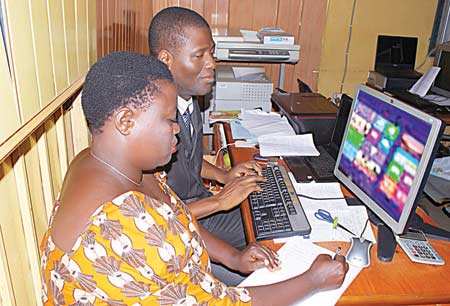 Alimi Banire and his wife researching on a PR Campaign for a client