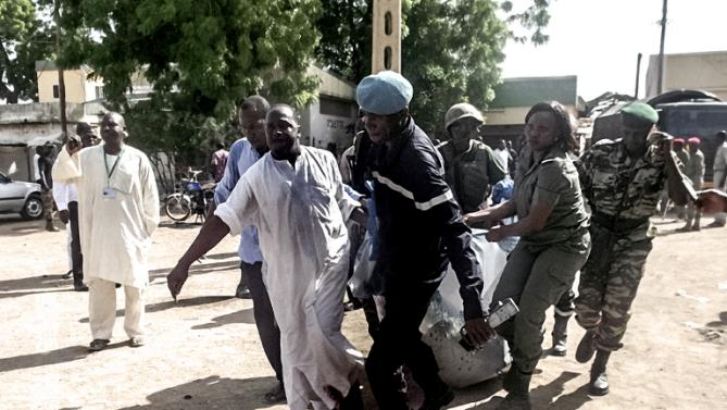 Security forces transport the remains of some victims of a double blast in the northern Cameroonian . PHOTO: yahoo
