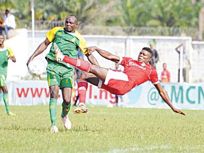 Kano Pillars' Adamu Mohammed (left) tries to evade Adeleye Olamilaken of F.C IfeanyiUbah's challenge during their Glo Premier League game…yesterday.     PHOTO: LMC.