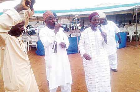 Deputy National Missioner, Nasirul-Lahi-il Fathi Society of Nigeria (NASFAT), Moruf Onike Azeez (right) at the prayer for the nation in Alausa, Lagos...on Wednesday