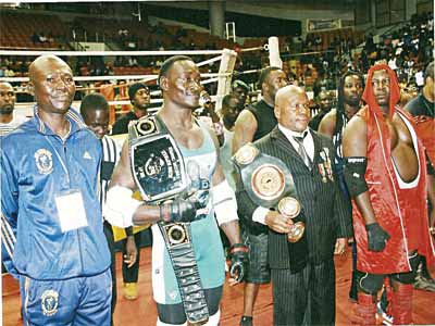 Power Lee with officials of Pro Wrestling Africa and Michel Noudem before the fight.