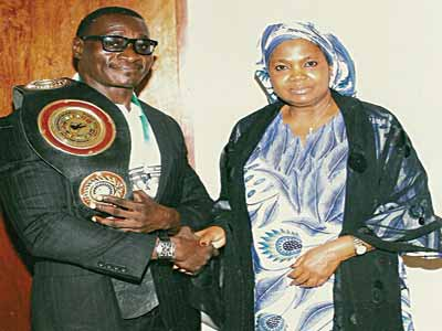 Power Lee with Nigerian High Commissioner to Cameroun, Ambassador Hadiza Mustapha, during a reception after the fight.