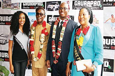Mr. Nkem Owoh and Mr. Bolaji Rosiji flanked by guests at the recent opening of Gaurapad Charities