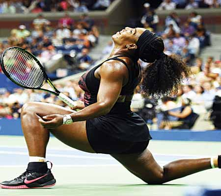 Serena Williams celebrates after beating her older sister, Venus, at the on-going U.S. Open…yesterday.        PHOTO: AFP.