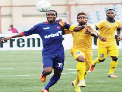 A player of Sharks FC on Eunisell jersey (left), battling for the ball in the on-going Nigerian Premier League. The company says it will continue to support the league.