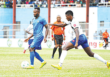 Jamiu Alimi of Sharks pursues Enyimba of Aba star, Mfon Udoh, during a recent Nigerian Professional Football League game. The Blue Angels will tackle Dolphins in a Port Harcourt derby… on Sunday.