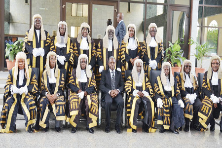 Vice President Yemi Osinbajo (middle) with Supreme Court justices shortly before the event marking the New Legal Year in Abuja…yesterday.
