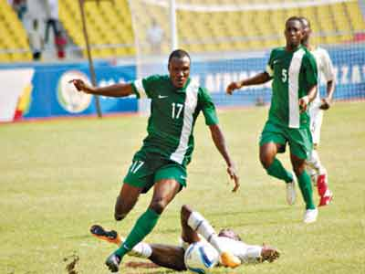 Nigeria's Aminu Umar (left) outruns a Ghanaian defender when they met in their opening game of the All Africa Games football event in Congo…on Wednesday. PHOTO: CAF